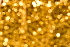 Golden Sparkle. Defocused golden light. Blurry lights Royalty Free Stock Photos