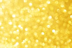 Golden sparkle glitters with bokeh effect and selectieve focus. Festive background with bright gold lights, champagne bubble. Christmas mood concept. Copy royalty free stock photos