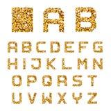 Golden sparkles alphabet font letters Royalty Free Stock Photo