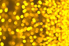 Golden sparkles background. Defocused picture of illumination curtain royalty free stock photo