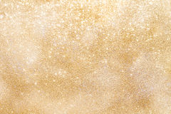 Golden sparkling background with copy space Stock Photos