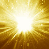 Golden sparkling background with intense glowing sparkles and glitter royalty free stock photos