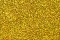 Golden sparkling background from small sequins. Closeup. Brilliant shiny backdrop from textile. Shimmer yellow paper stock photo