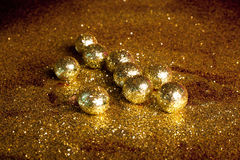 Golden sparkling balls Royalty Free Stock Images