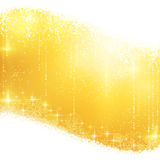 Golden sparkling Christmas background. Shiny light effects with magical stars and glittering snowflakes in shades of gold between wavy contour. Great for the Stock Images
