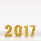 2017 golden sparkling glitter number on white studio room backgr. Ound, resolutions for new year Royalty Free Stock Photo