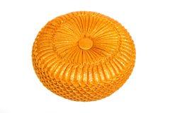 Golden sparkling pillow on white background. Stock Image