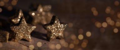 Golden sparkling stars. Golden glittering stars decorated very festively royalty free stock image