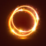 Golden sparkling vector rings, light flash circles Stock Image