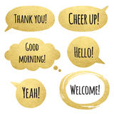 Golden speech bubbles set with words Royalty Free Stock Images