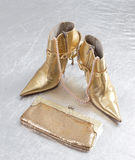 Golden spike heels and purse Stock Images