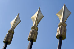 Golden spikes on iron fence Stock Image