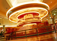 Golden spin of carousel Stock Photography