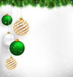 Golden spiral and green christmas balls with pine branches in sn Royalty Free Stock Photo