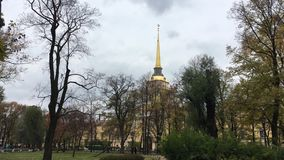 The Golden spire of the Admiralty in tree branches stock footage