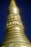 Golden spires of Buddhist stupas in temple Stock Photo