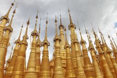 Golden spires of Buddhist temple Royalty Free Stock Image