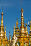 Golden spires at the Shwedagon pagoda Stock Images