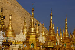 Golden spires of stupas Stock Photos