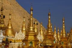 Golden spires of stupas Stock Photos