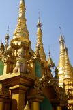 Golden spires of stupas Stock Photography