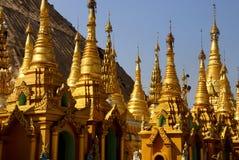 Golden spires of stupas Stock Photo