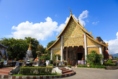 The golden spirit house in front of Chedi Luang Temple, Chiang Mai, Thailand Stock Photos