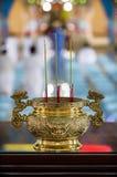 Golden spiritual vase with smoking aromatic candles Royalty Free Stock Photos