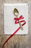 Golden spoon decorated with red bow Royalty Free Stock Images