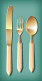 Golden spoon, fork and table knife Stock Photo