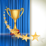 Golden sports cup on blue curtain background with flying stars. Royalty Free Stock Photo