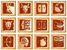 Golden squares with signs. Decorative golden squares with brown signs of the zodiac. Available as Illustrator-file Stock Images