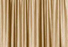 Golden stage curtain Royalty Free Stock Images