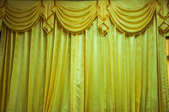Golden stage curtain Stock Images