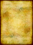 Golden stained grunge paper Stock Image