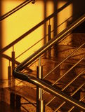 Golden staircase. Sunshine light on modern stairs Stock Photos