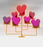 Golden stand with pink red hearts with background blur Royalty Free Stock Image