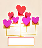 Golden stand with pink red hearts card Royalty Free Stock Photography