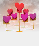 Golden stand with pink red hearts with cloudy sky Stock Photo