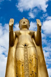 Golden standing Buddha statue Stock Photos