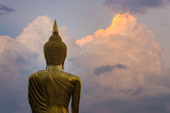 Golden standing buddha statue Royalty Free Stock Photography