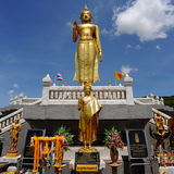 Golden Standing Buddha Statue Stock Images