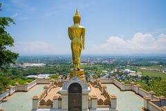 Golden standing buddha statue Royalty Free Stock Photos