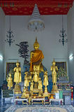 Golden standing Buddha statues in Wat Pho. Bangkok, Thailand royalty free stock photography