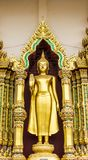Golden standing buddha royalty free stock photography