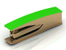 Golden stapler with a green handle Stock Images