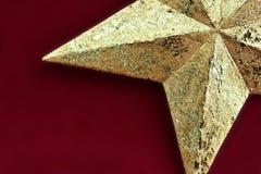 Golden star. A golden cardboard star segment Stock Images