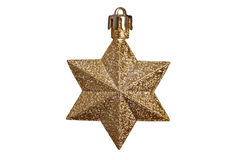 Golden star. Christmas tree decoration - golden star on white Stock Image