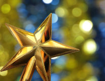 Golden star on the bright background Stock Image