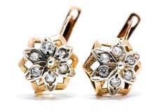 Golden star earrings Royalty Free Stock Image